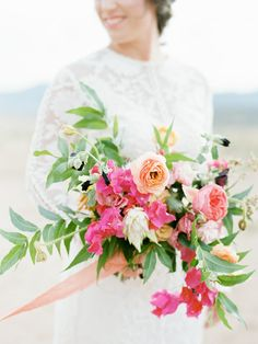 Peach ranunculus and pink garden roses with fresh greenery and hot pink bougainvillea: http://www.stylemepretty.com/2015/07/08/23-gorgeous-wildflower-inspired-bouquets/