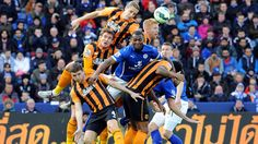 Players from Leicester City (blue) and Hull City compete for a header during a Premier League match in Leicester, England, on Saturday, March Hull City, Premier League Matches, Leicester England, Basketball Court, Header, Sports, March, Blue, Hs Sports