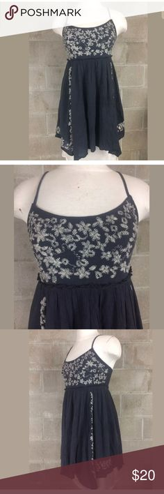 American eagle outfitters spaghetti  strap dress merican Eagle Outfitters Navy Spaghetti Strap Embroidered Empire Dress size Medium. Lined  Approx. Measurements Unstretched Flat: Armpit to armpit ~ 15.75 inches Waist ~ 14.5 inches Length ~ 26 inches American Eagle Outfitters Dresses Mini