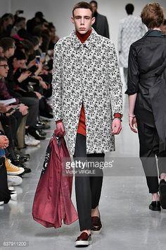 News Photo : A model walks the runway at the Matthew Miller...