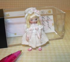 """Miniature Ethel Hicks Angel Children """"Nanette"""" Limited to 50,  DOLLHOUSE 1:12   """"Marcella"""" measures 1 1/2"""" tall. She's wearing a white Swiss dot dress w/ lace yolk & two tiny bows tied from 3/32"""" wide pink ribbon. A matching pink bow accents her lace-trimmed cap. She has white socks & pink shoes painted on her feet. She's very special (limited to 50), & she's an excellent accessory for any girl's room, Victorian home or antique toy shop."""
