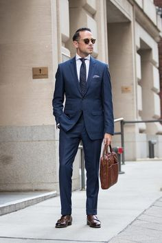 Not sure who is the model but I'm a big fan of the navy suit paired chocolate brown double Monk shoes leather handbag white shirt silk polka dot tie and blue and white pocket square Mens Fashion Blog, Mens Fashion Suits, Mens Suits, Fashion Guide, Groom Suits, Groom Attire, Style Fashion, Womens Fashion, Business Mode