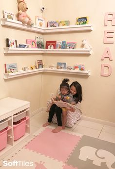 Cute corner nook in a girl's playroom using SoftTiles Safari Animals Play Mat in Light Pink, Light Gray, and White.