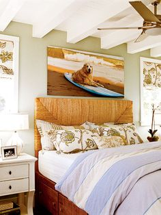 A woven headboard paired with soft green-and-blue bed linens give this master bedroom in Santa Cruz, California, a laid-back, earthy feel.