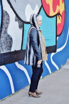 Layering a long vest over a jacket for boomer style