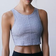 """New FP  Warm Up Dance Crop - Grey SM From Free People's own Movement line.  Activewear top with floral embroidery detail. Features their Picot Performance blend of Rayon / Nylon /Spandex.    Fully lined.  Grey/Gris, Size Small.  Bust measures 30"""", Length 15"""". Free People Tops Crop Tops"""