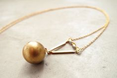 It looks like a pearl but it's actually a locket for hiding secret messages!