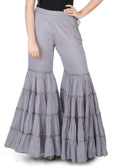 Cotton Mulmul Sharara Style Pant in Grey This readymade attire is designed with Dangles Do note: Top shown in the image is just for presentation purpose only. (Slight variation in actual color vs. Gharara Designs, Kurta Designs Women, Kurti Neck Designs, Kurti Designs Party Wear, Dress Neck Designs, Salwar Designs, Blouse Designs, Indian Designer Outfits, Indian Outfits