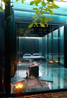 Glass room. Imagine laying in a room like this with a person you love while it's raining hard outside or snowing. . .