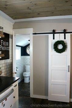 DIY sliding door and wood ceiling provide farmhouse flair!