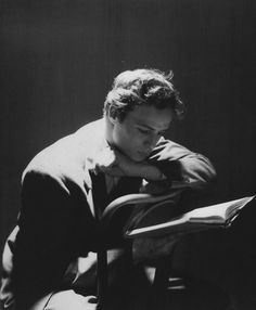 Marlon Brando photographed reading the script for A Streetcar Named Desire after garnering media attention for his role as Stanley Kowalski in the stage production of the play. Photographed by Cecil Beaton, 1947.