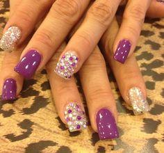 Purple nails with jeweled nail