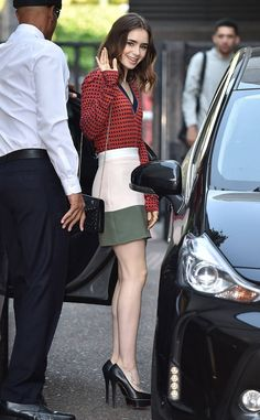 Lily in London! The actress gives a wave during an appearance at ITV Studios while sporting her stylish Charlotte Olympia pumps.