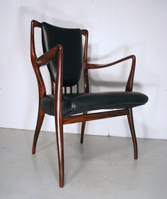 A J Milne rosewood and leather chair, Heals, 1940s/1950s