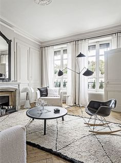 monochrome living room with Serge Mouille floor lamp | a french apartment
