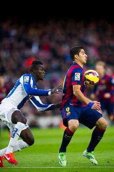 Luis Suarez of FC Barcelona controls the ball close to Eric Bailly of RCD Espanyol during the La Liga match between FC Barcelona and RCD Espanyol at Camp Nou on December 7, 2014 in Barcelona, Catalonia.