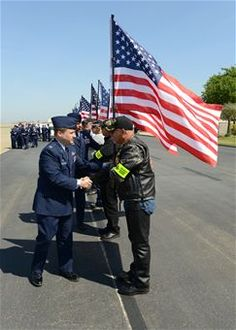 Fallen Airman returns home. 5/17/2013 - U.S. Air Force Col. Phil Stewart, 9th Reconnaissance Wing commander, shakes hands with members of the Patriot Guard Riders at Beale Air Force Base, Calif., May 10, 2013. The Patriot Guard Riders were present for the dignified transfer of Staff Sgt. Richard Dickson. (U.S. Air Force photo by John Schwab/Released)