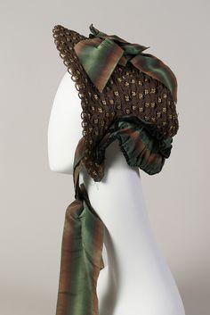 Bonnet: ca. 1860-1969, American, straw with ombré striped taffeta ribbon, velvet. KSUM 1994.048.0019