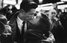 Jay Maisel, Couple kissing, man with horn, New Year's Eve, mid 1950s