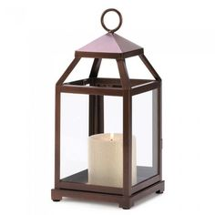 Bronze Contemporary Candle Lantern  Geometric style has glass panels on the bottom and an open top. Burnished copper glaze. Loop at top for hanging or can stand on its own.  Weight 1.9 pounds  5.5 x 5.75 x 12 inches tall  Iron and glass  Candle not included