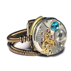 This steampunk ring inspired by mechanical and organic shapes is made by twisting and coiling wire tightly. This original design by Daniel