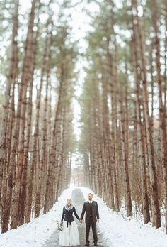 Brides.com: . Snow-dusted trees surround the couple in this striking moment.