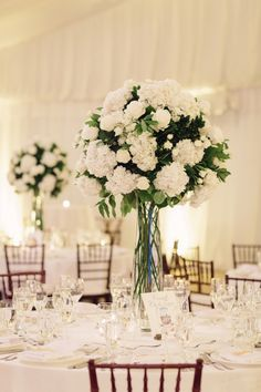 Hydrangea and rose centerpiece: http://www.stylemepretty.com/new-jersey-weddings/gladstone-new-jersey/2017/03/03/traditional-white-wedding-day-with-a-classic-designer-dress/ Photography: Tanya Salazar - http://tanyasalazar.com/