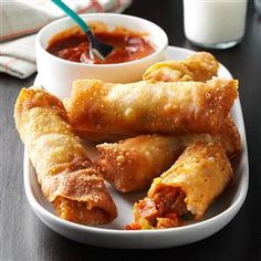 "Pizza Rolls Recipe -""This is my husband's version of store-bought pizza rolls, and our family loves them,"" writes Julie Gaines of Normal, Illinois. ""Although they take some time to make, they freeze well. So when we're through, we get to enjoy the fruits of our labor for a long time!"""