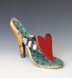 Shoe with huge red heart.