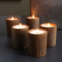 """Votive Sprockets Assortment - Nordic metal votive candle holder with a rough rusty finish - Approximate burn time 8 hour burn time - 3.5"""" x 2"""" - Trim wick to 1/4 inch before burning. Always use caution with any candle product. Never leave a burning candle unattended. Try our votive candles this Christmas to light up your party.http://www.scandinavianshoppe.com/store/p/1401-Votive-Sprockets.html"""
