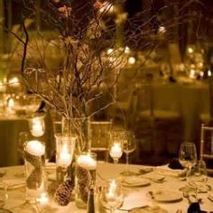 Picture is blurry. But there is pine ones under the candles and I love the twigs in a vase. Goes with your whole wood theme! (: