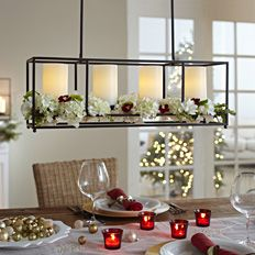 Country Chirstmas tablescape and centerpiece with red, white and cream candles and flowers