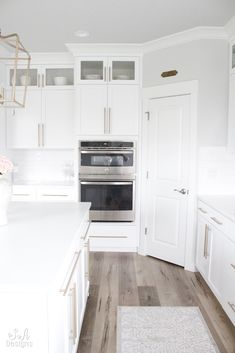 We just finished building our new home here in the Pacific Northwest and today I am taking you on a tour of our bright white kitchen!