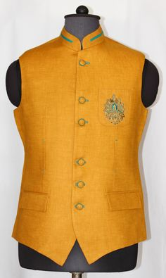 This stylish golden yellow jacket is a combination of vest coat and Nehru jacket.Fantastic motif at front enhancing this stylish jacket's look.Slight variation in color and fabric might be possible. All other accessories are for photographic purpose only Nehru Jacket For Men, Waistcoat Men, Nehru Jackets, Kurta Pajama Men, Kurta Men, Mens Sherwani, Indian Men Fashion, Mens Fashion Wear, Designer Dress For Men