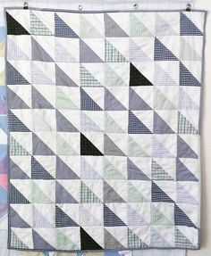 upcycled blue green and white baby quilt recycled fabric half square triangles