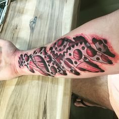 3D torn skin tattoo done by Spoox from The Dead Mans Hand Townsville, absolutely love the Renthal Motocross sprockets and the muscle is sitting where it should be too! #3D #tattoo #ink #love it