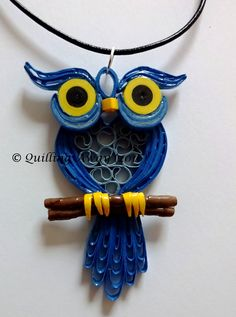 Quilled paper owl pendant. https://www.facebook.com/Quilling-Away-1425980714336853/?ref=bookmarks