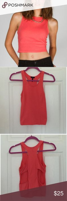 Cropped Cutout Tank This adorable and chic high neck cropped tank is perfect for those warmer months! The back has a cute cutout, for a little added edge! Has only been worn one time, in pristine condition! Pease feel free to ask questions! Nollie Tops Tank Tops