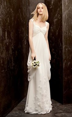 White by Vera Wang for David's Bridal - Not sure if this would look good on my curvy figure or make me look huge, but I like it.