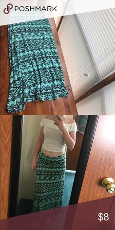 Mint Maxi Skirt Mint colored maxi skirt w/ black aztec pattern. well worn but still in great condition. i am 5'3 and it come right down to my ankles. it is 33 inches from top to bottom. i know the tag says large but i am a small and it fits perfectly Charlotte Russe Skirts Maxi