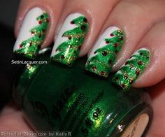 By Kelly R. Tis the season for festive #nailart. I completed this look using China Glaze Going in Circles, White on White, Angel Wings and Ruby Pumps. I painted the outline of the nails first. Nail art like this isn't hard. Just think of it in lines. Once the outline was finished I filled in the trees, applied the garland in a diagonal path and dotted on the ornaments. @bloomdotcom