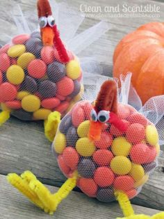 Turkey candy treats made from a mesh bag pipe cleaners and googly eyesfiled with Reese's Pieces or fall colored M