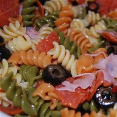 Tri-Color Pasta Salad 1 pound package of tri-color rotini pasta campaignIcon 1/2 of a medium red onion, chopped 1 stalk of celery, chopped 1/2 of a medium green bell pepper, chopped campaignIcon 1/2 of a medium red bell pepper, chopped 1 can of medium pitted black olives, sliced 1 cup Italian dressing 1 tomato, seeded and chopped Parmesan cheese, to garnish Crumbled bacon, to garnish, optional