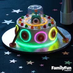 The Extra-Special, Extraterrestrial Cake: Look what's landed on the the table: it's clearly a UFO -- an Unusually Festive Object! This flying saucer, piloted by a little green man, is sure to light up the party.