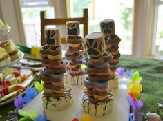 Luau Theme: Activity-have a totem building competition. (With pretzs,marshmallows & ring cookies)