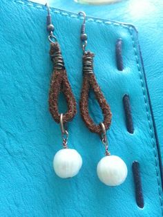 Large freshwater pearls dangle from leather loops, wire wrap, antique copper fish hook wires.
