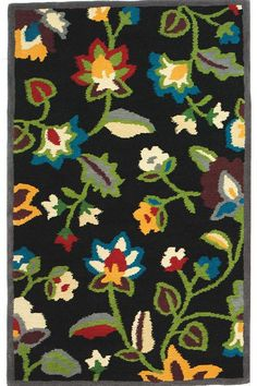 I am leaning towards a black background folk floral rug. This might be the one.