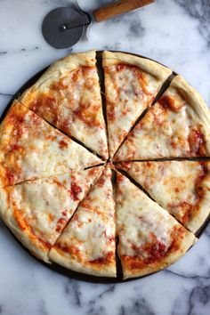 The Best New York Style Cheese Pizza - The whole family will love this easy, cheesy, delicious homemade pie! Ditch the delivery!
