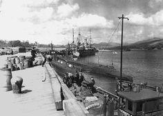 Two submarines of US Navy Submarine Squadron 50 at Rosneath, Scotland, United Kingdom, circa 7 Dec 1942; sub possibilities were USS Barb, USS Blackfish, USS Herring, USS Shad, USS Gunnel, and USS Gurnard