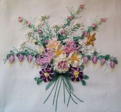 A pillow top I embroidered in a class designed by Ganet Burr.  Both silk ribbon embroidery and Brazilian embroidery.